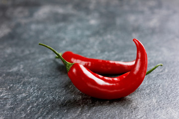 chili pepper on a black stone background