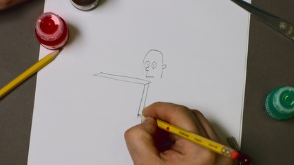 The man draws a pencil on paper