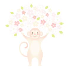 バンザイをするサルと満開の花