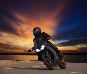 young man riding big bike motorcycle leaning curve on asphalt hi
