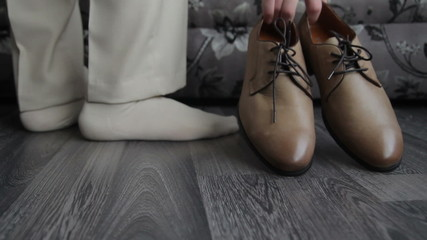 Man takes  shoes, close up