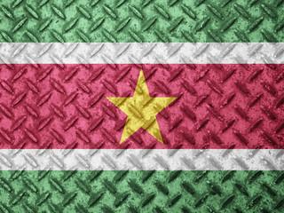 Suriname flag on grunge wall