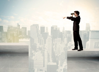 Businessman standing on the edge of rooftop