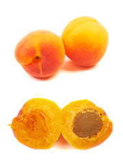 Ripe orange apricots, peaches isolated on white background.