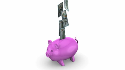 Money falling into a Piggy Bank