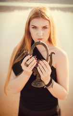 gothic girl with long red hair and old mirror