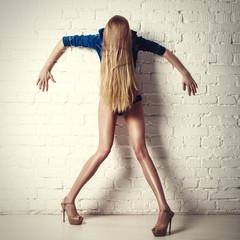 crazy posing young long legs model. fashion photo