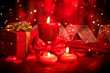 Valentine red heart shaped candles and gift on red silk