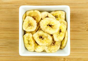 Tasty banana chips in bowl