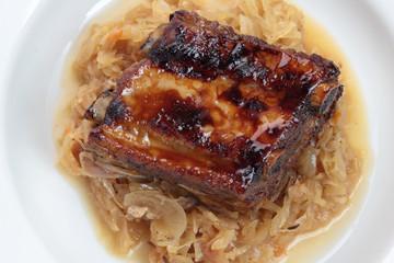Pork ribs glazed and roasted, served on sauerkraut.