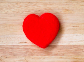 Valentines Day background red heart on wooden background