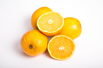 Whole and Half Naval Oranges on White