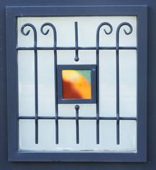 vintage metal art ornamentation window. filtered image