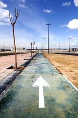 Urban scene. Bike path and blue sky.Sport in the town.