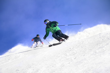 Two Skiers skiing