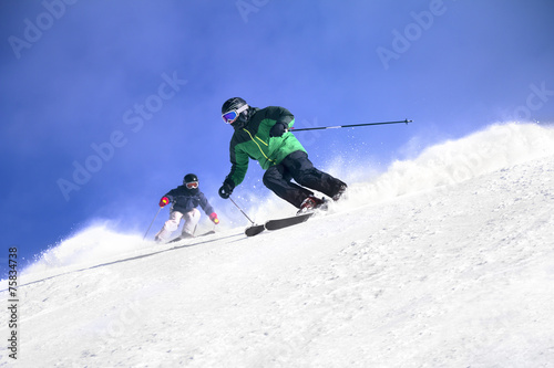 Foto op Canvas Wintersporten Two Skiers skiing