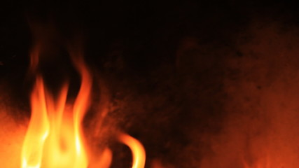 Close up burning fire with grunge background