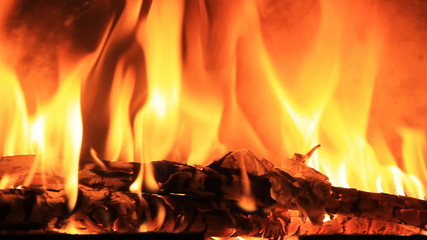 Close up burning wood in fireplace