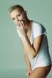 Studio fashion photo of  smoking woman