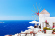 Famous windmills in Oia town on Santorini island, Greece