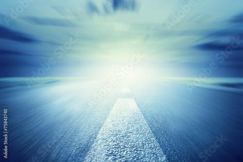 Long empty asphalt road towards light. Motion, speed - 75843740