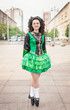 Young woman in irish dance dress posing outdoor