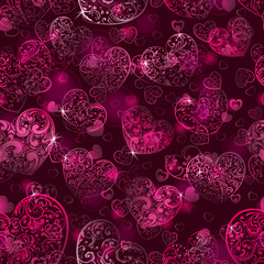 Seamless pattern of hearts in dark pink colors