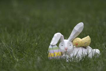 Wooden Easter Bunny and Chick Sleeping in Grass