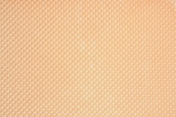 Golden waffle background with regular pattern
