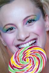 Sweet Greek girl holding a lollipop heart