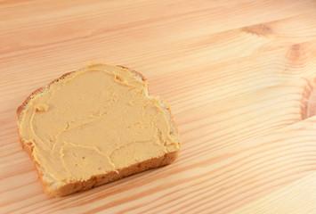 Peanut butter on a slice of bread