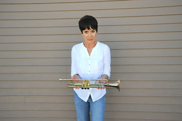 Mature female trumpet player.