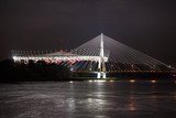 Night view of bridge and stadium in Warsaw