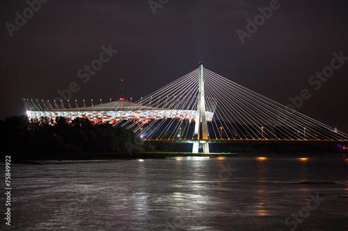 Fototapeta Night view of bridge and stadium in Warsaw
