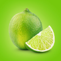 Citrus lime fruit with slice on green background
