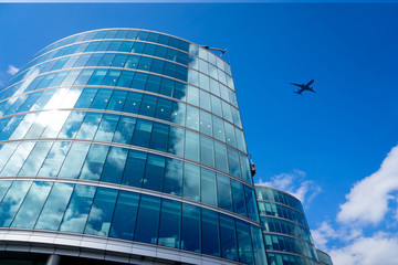 A jet airplane business office towers building, London