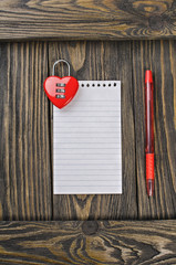 Love letter, heart lock on old wood background.