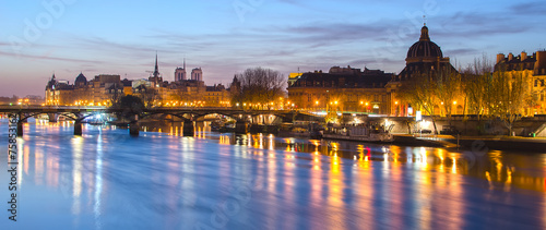 Seine river and Old Town of Paris (France) at night - 75853162