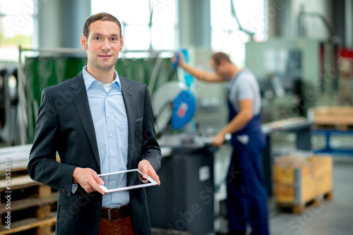young boss in his factory - 75853310