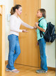 Mother and son near door