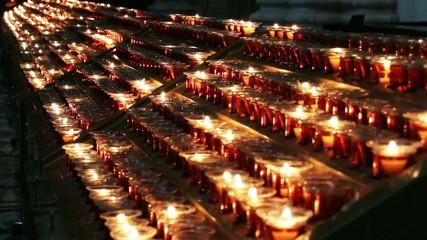 Burning candles in a church N8