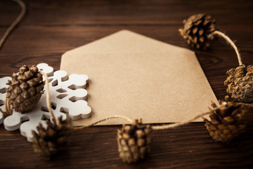 Envelope with Christmas decoration on wood table