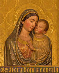 Seville - The wooden baroque relief of Madonna