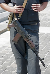 Ukrainian police officer with Kalashnikov automatic rifle.