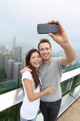 Hong Kong Victoria Peak tourists couple selfie