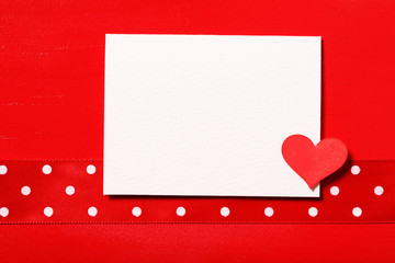 Blank white card with little red heart