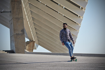 Man riding on a longboard skate