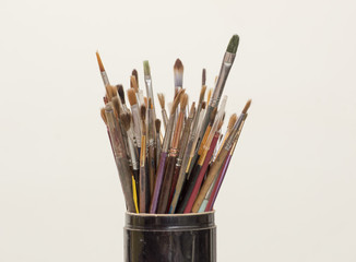 Brushes in black jar as painter's tool