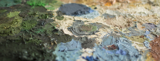 Cropped detail of dry oil paint on a palette