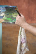 canvas print picture - painters hand with brush and rag